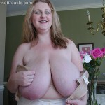 38 L-cup huge boobs big tits BBW redhead Sapphire
