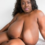 black BBW huge big great massive mammaries breasts boobs tits knockers norks belly butt BBBW vagina pussy fanny cunt twat front-bottom lingerie underwear white tight bra panties knickers pants<br />