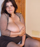 Alicia Loren 36JJ nipples poking out of a revealing mesh top at DivineBreasts.com
