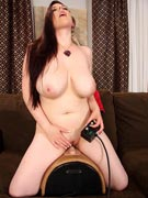 Angela White rides the wild Sybian fucking machine at DDFbusty.com
