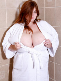Anorei Collins massive NN-cup breasts in big boobs in a bathrobe tits photos from AnoreiCollins.com