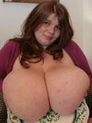 Giant tits on a platter with huge breast plates of gigantic juggs from massive boob beautiful Anorei Collins at BigTitsGlamour.com