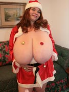 Anorei Collins 38LL as super busty sexy Mrs Santa Claus with gigantic breasts and Christmas cleavage courtesy of Big Tits Glamour - BigTitsGlamour.com