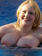 Ashley Sage Ellison big boobs floating in the swimming pool like large breast buoys at DreamOfAshley.com