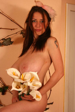 Anya Sakova with a dead bird on her head and gorgeous G-cup big boobs bare in classy nude photos from TopHeavyAmateurs.com