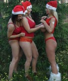 Ines Cudna, Malina May & Kora Kryk as lesbian Christmas elves at BoobsGarden.com
