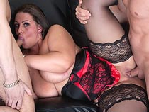 Big udders Dani Amour riding on cock and getting spitroasted videos from BustyBritain.com