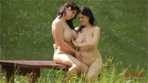 Busty lesbian boob play in the grass with Paula Martini & Klara in girl-on-girl videos from Big Tits Glamour - BigTitsGlamour.com