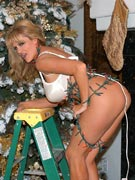 Christmas tits trimming the tree in big boobs Merry Christmas masturbation photos from busty MILF slut Kelly Madison 34FF at KellyMadison.com