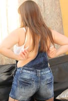 Cindy Milley big boobs in overalls taking off her H-cup bra in big tits topless photos from CindyMilley.com