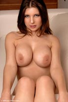 Olivia with DD-cup breasts from MC-Nudes.com