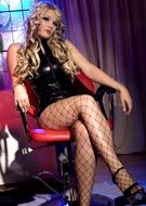 Faith in black latex and fishnet stockings in fetish photos from FetishByAnna.com