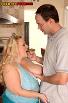 Cassie Blanca feeding & fucking in busty plumper fat feeder fetish photos from FeedHerFuckHer.com