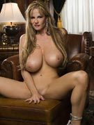 Kelly Madison 34FF puts her pussy on display at KellyMadison.com