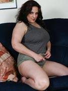 Mellie D big boobs & erotic eyebrows from BustyBrits.com