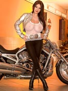 Busty Merilyn Sakova 32G busty biker babe with a Harley Davidson V-Rod at BustyMerilyn.com