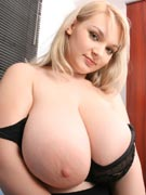 Beautiful busty big boobs blond in bed with cute little 36G Micky at Big Tits Glamour - BigTitsGlamour.com