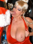 I saw mommy fucking Santa Claus in Christmas sex photos with FF-cup busty Christmas slut MILF Kelly Madison from KellyMadison.com