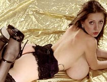 Anya Zenkova rolls over on her big boobs super slim and stacked tits courtesy of PinUpFiles.com