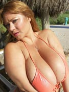 Samantha 38G boobs on wood bikini tits topless and sexy nude photos from Samantha38G.com
