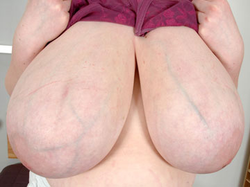 Sexy blue veins on breasts visible through translucent skin on the big veiny boobs of voluptuous veinous tits Venus from XX-Cel.com