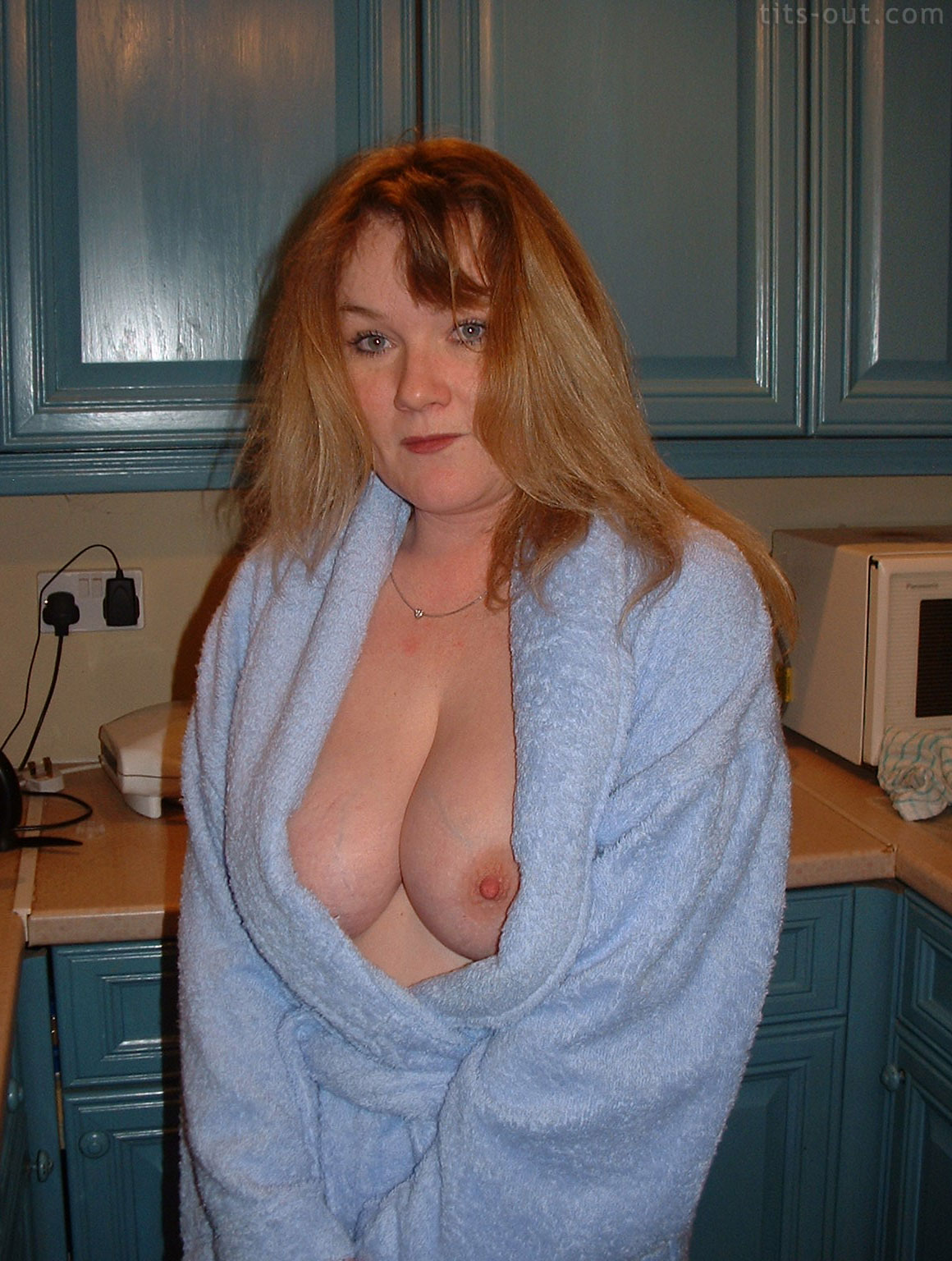 Big tits hanging out of robe