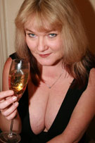 Vix tits-out with a glass of champagne at her BreastFiles Playmate Site